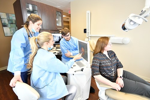 Faculty and students work together in the center for dental innovation.