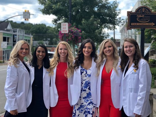 Brooke Dolin (second from right) poses with some of her classmates at their White Coat ceremony.