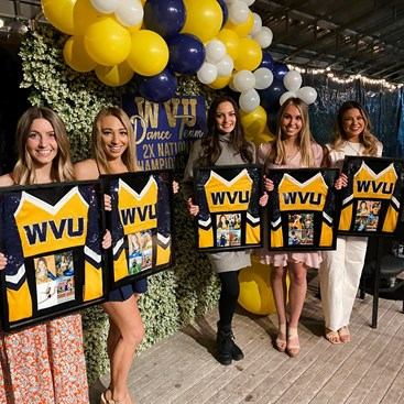 Claire Frank, first on left, and her WVU Dance teammates won a national title in 2021.